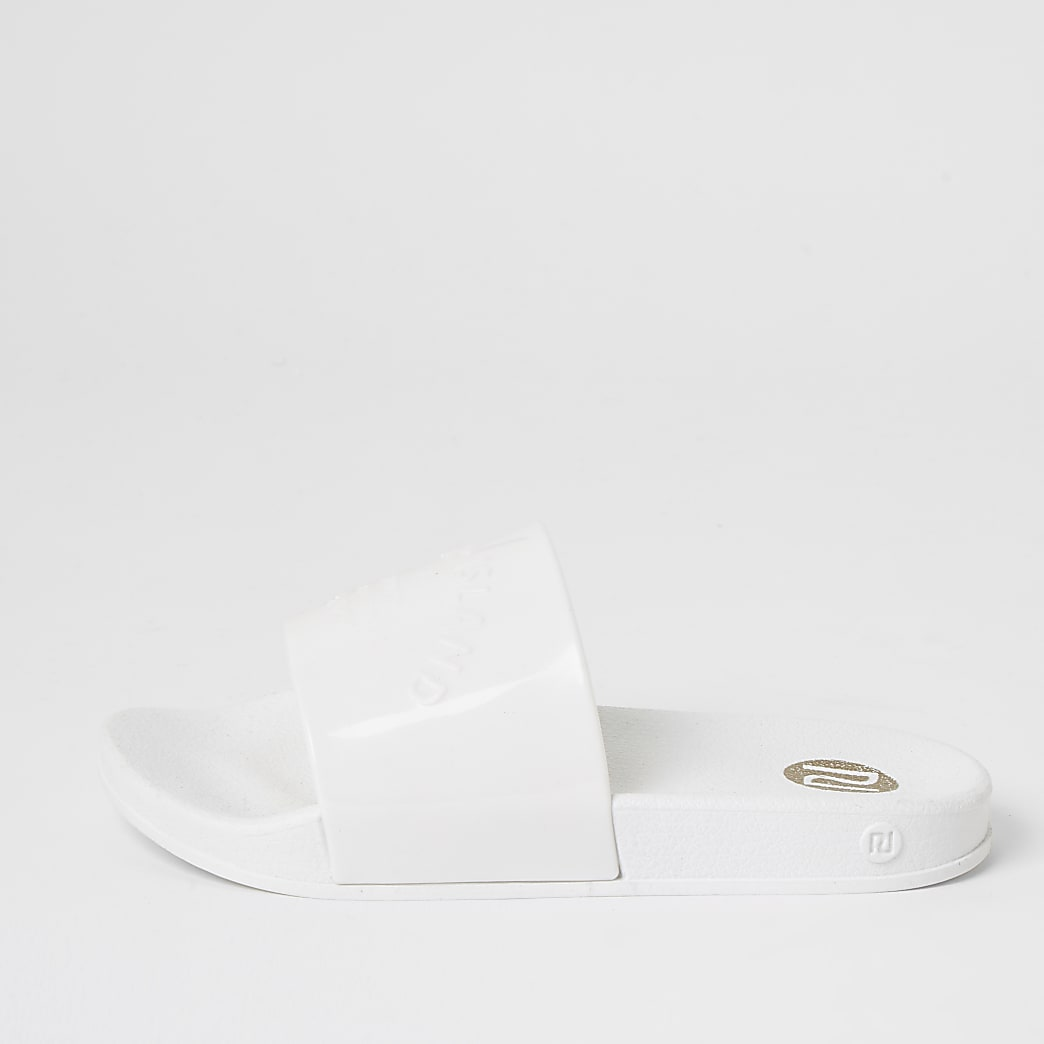 Girls white RI embossed jelly sliders