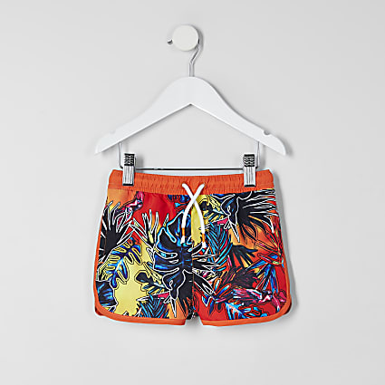 Mini boys orange tropical print swim shorts