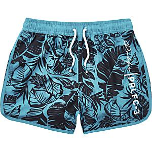 Leuchtend blaue Badeshorts mit Blattmuster für Jungen
