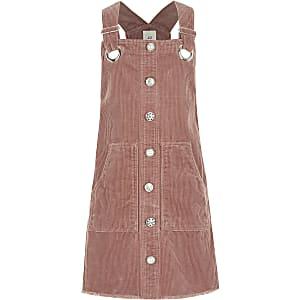 Roze corduroy overgooier voor meisjes met knopen voor
