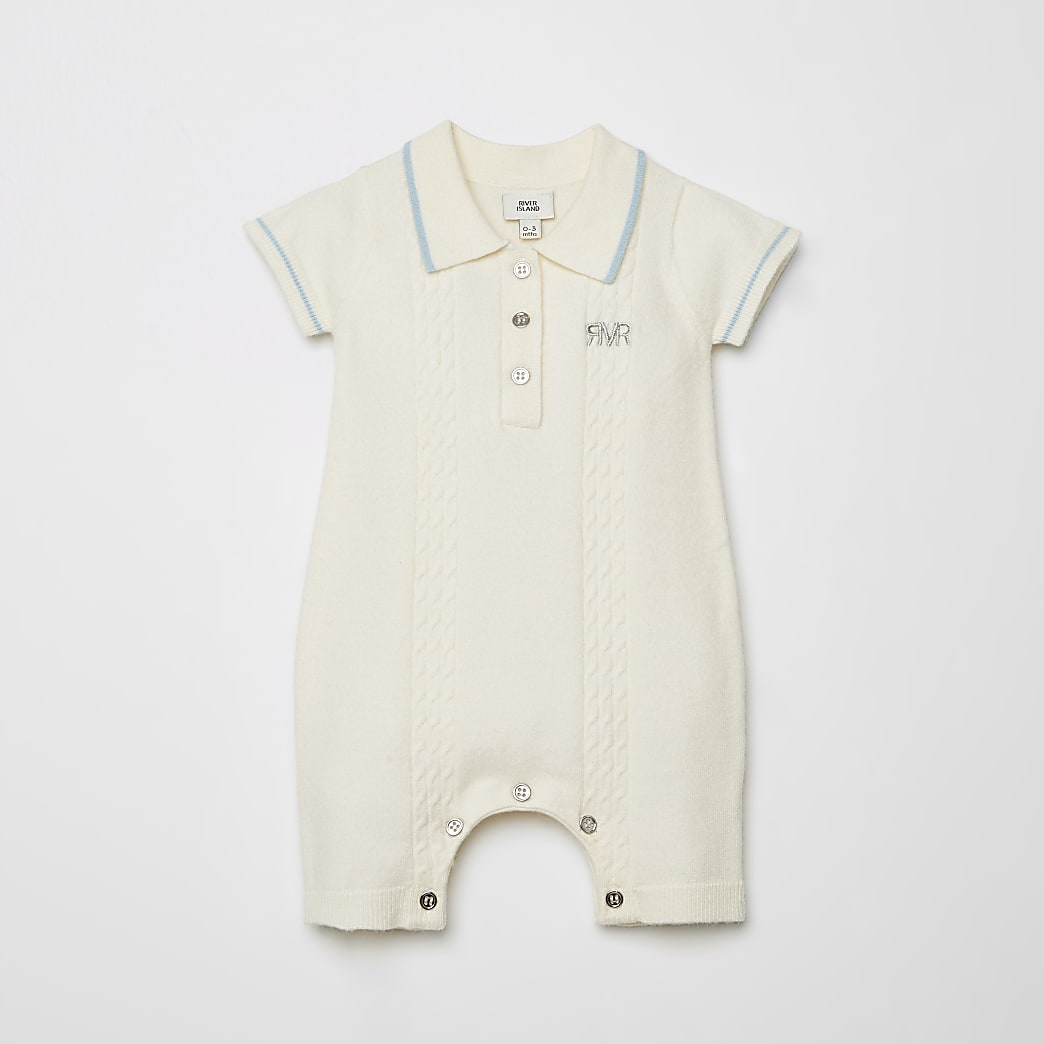 Baby beige cable knitted polo baby grow