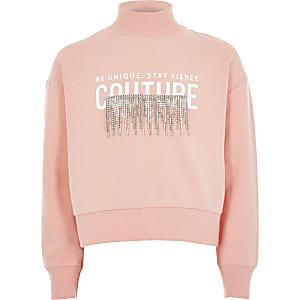 Koraalkleurige sweater met print en kwastjes met siersteentjes voor meisjes