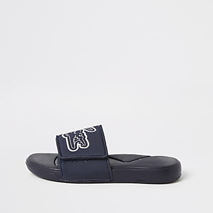 Boys Lacoste navy logo sliders