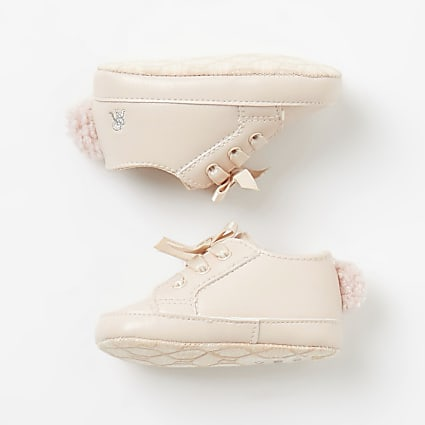Baby pink pom pom lace-up trainers