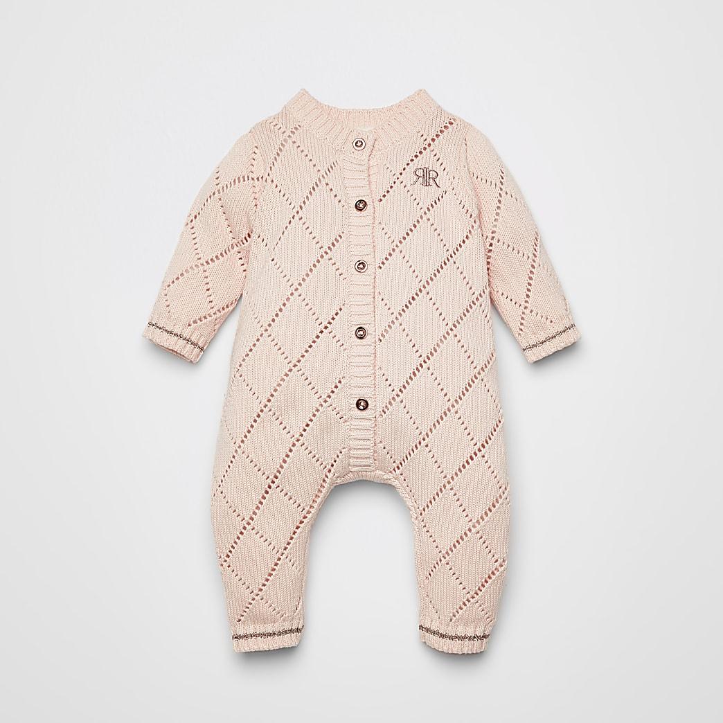 Roze pointelle gebreid rompertje voor baby's