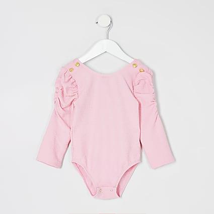 Mini girls pink textured long sleeve bodysuit