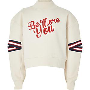 Crème sweatshirt met print en split in de mouwen