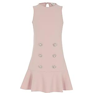 Roze jurk met peplum en verfraaide knopen voor meisjes