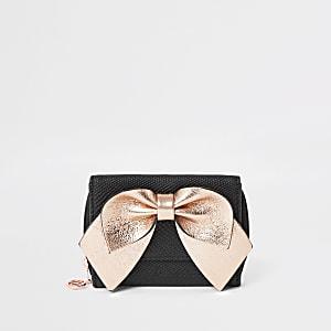 Zweifach aufklappbare schwarze Geldbörse mit Schleife in Rosa