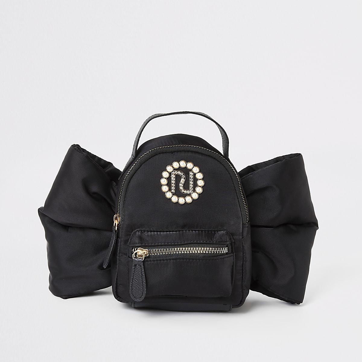 Zwarte mini rugzak met RI-logo en versierd met strik voor meisjes