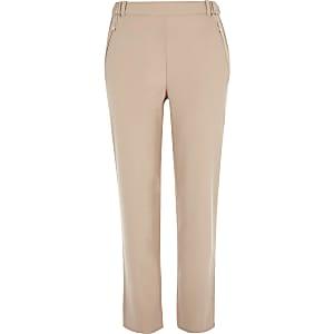 Pantalon rose avec détail zippé