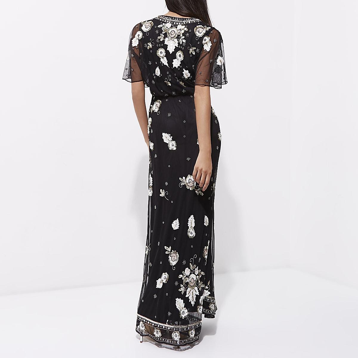 8ad9a1d77f6 Robe longue cape en tulle noire ornée de sequins - Robes longues ...