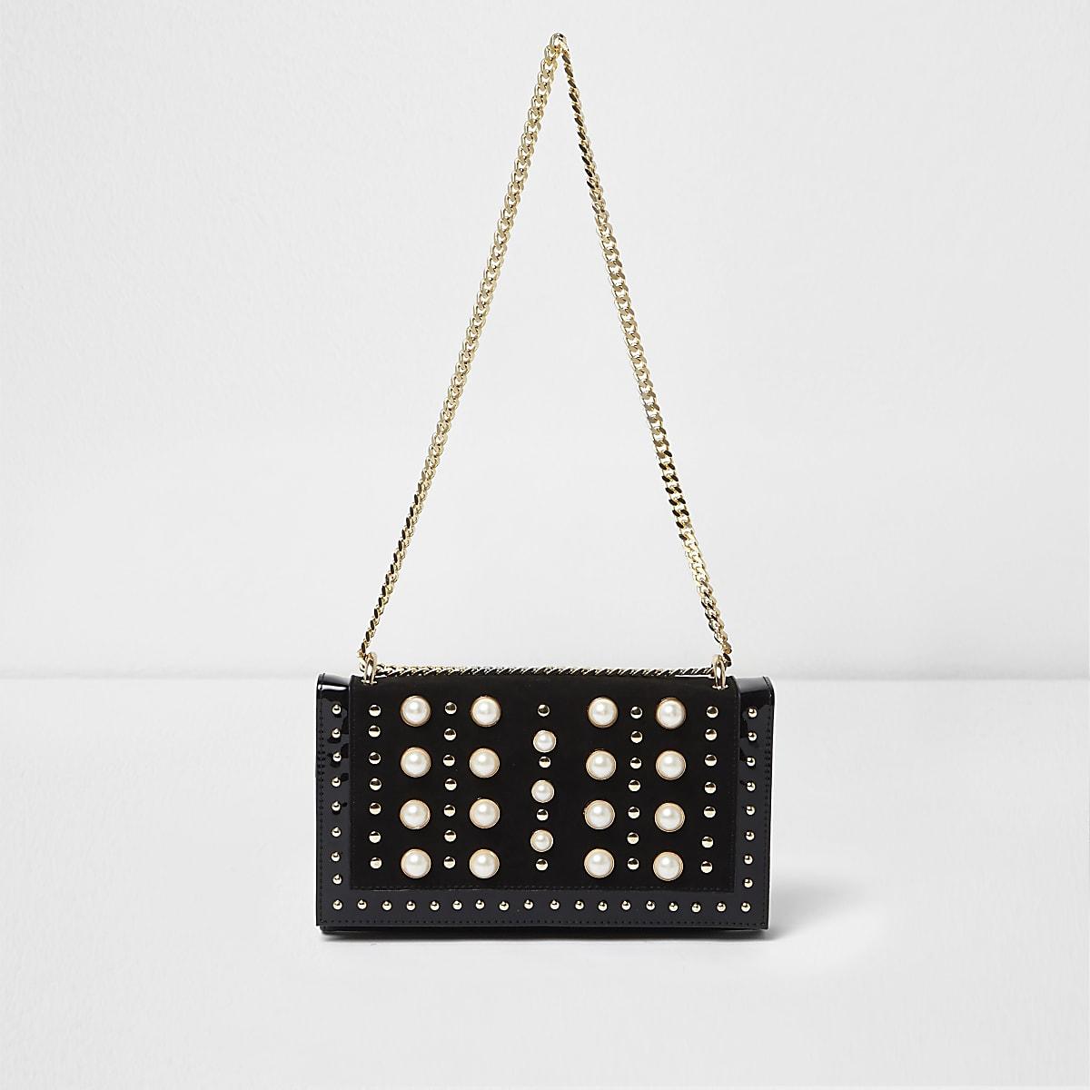 Sac noir orné de clous et de perles avec chaîne