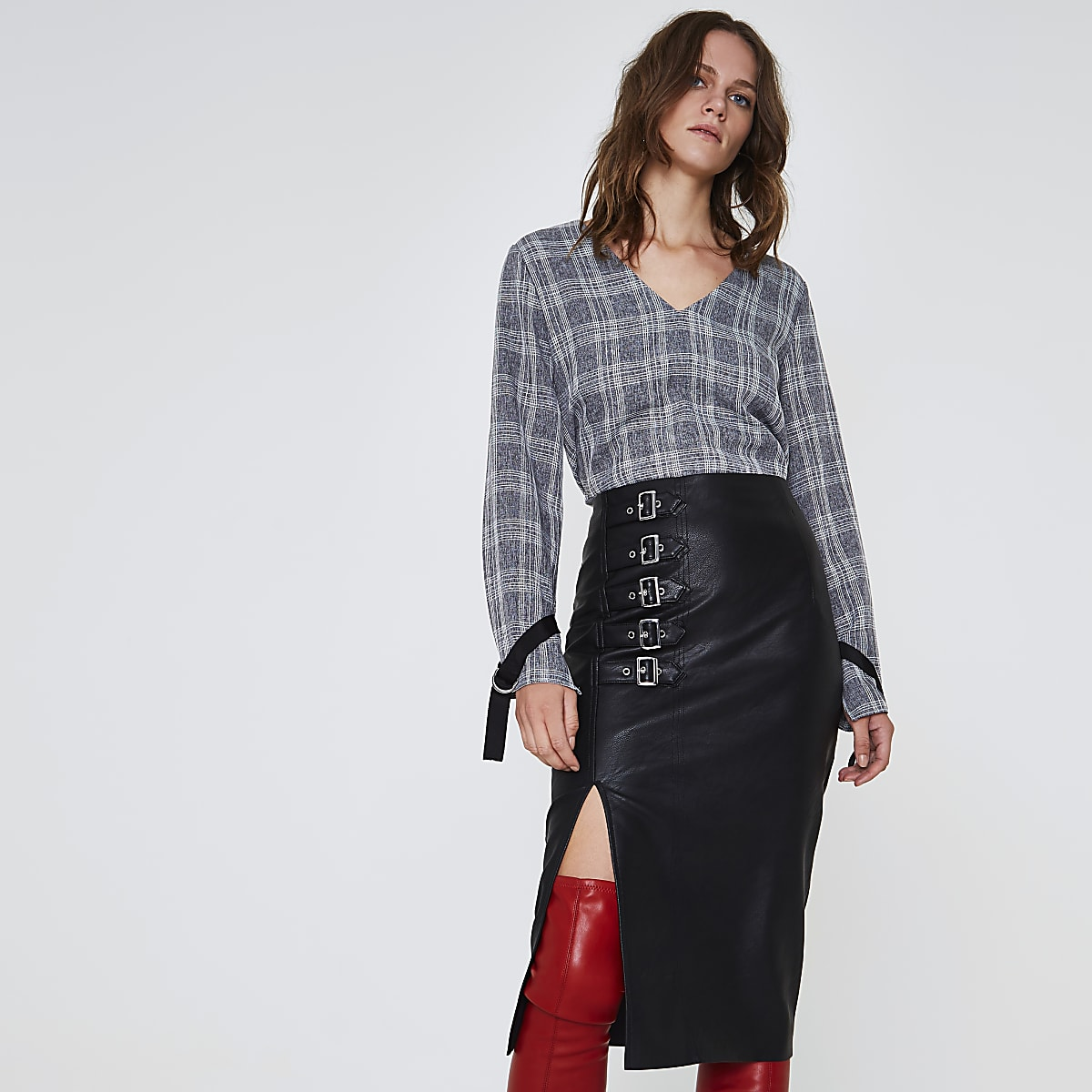 Black faux leather buckle pencil skirt