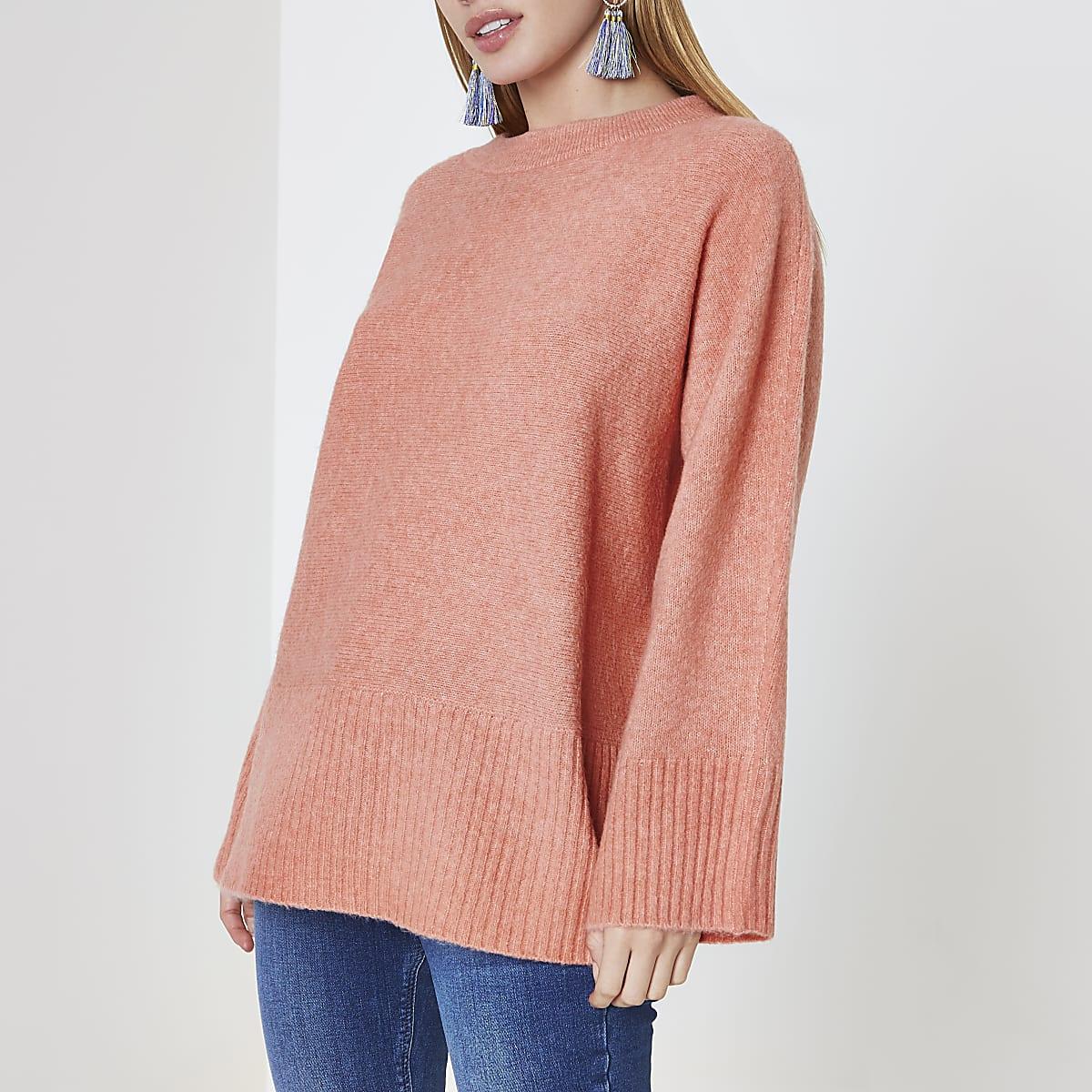 RI Petite - Oranje pullover met strik op de rug