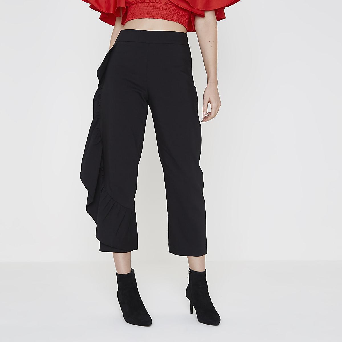 Zwarte cropped broek met ruches opzij