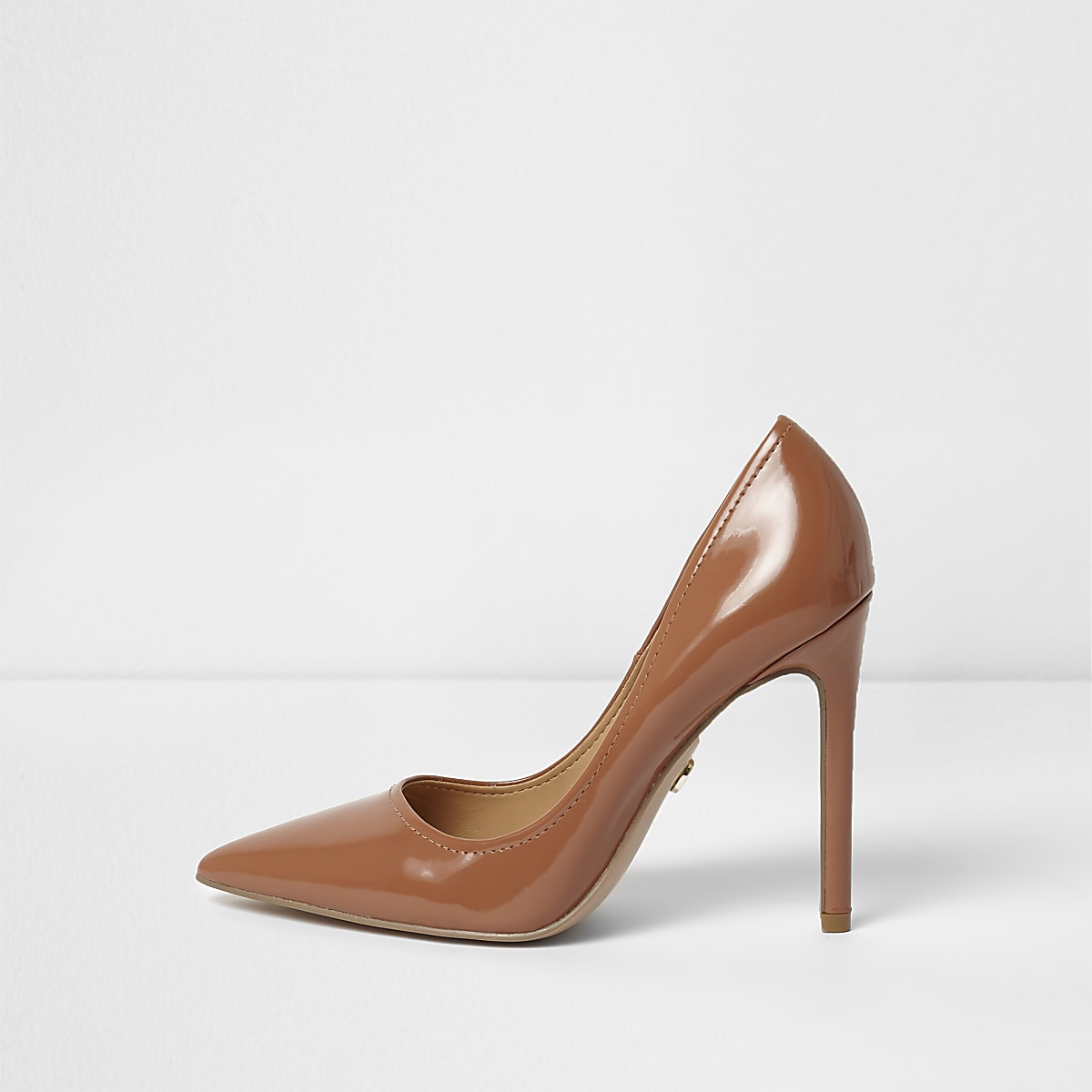 Tan patent pointed toe court shoes