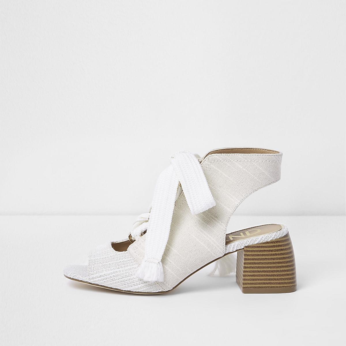 White canvas tie-up block heel shoe boots
