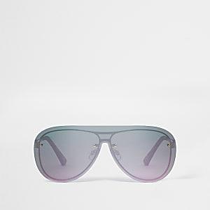 Goldene Sonnenbrille mit pinken Gläsern