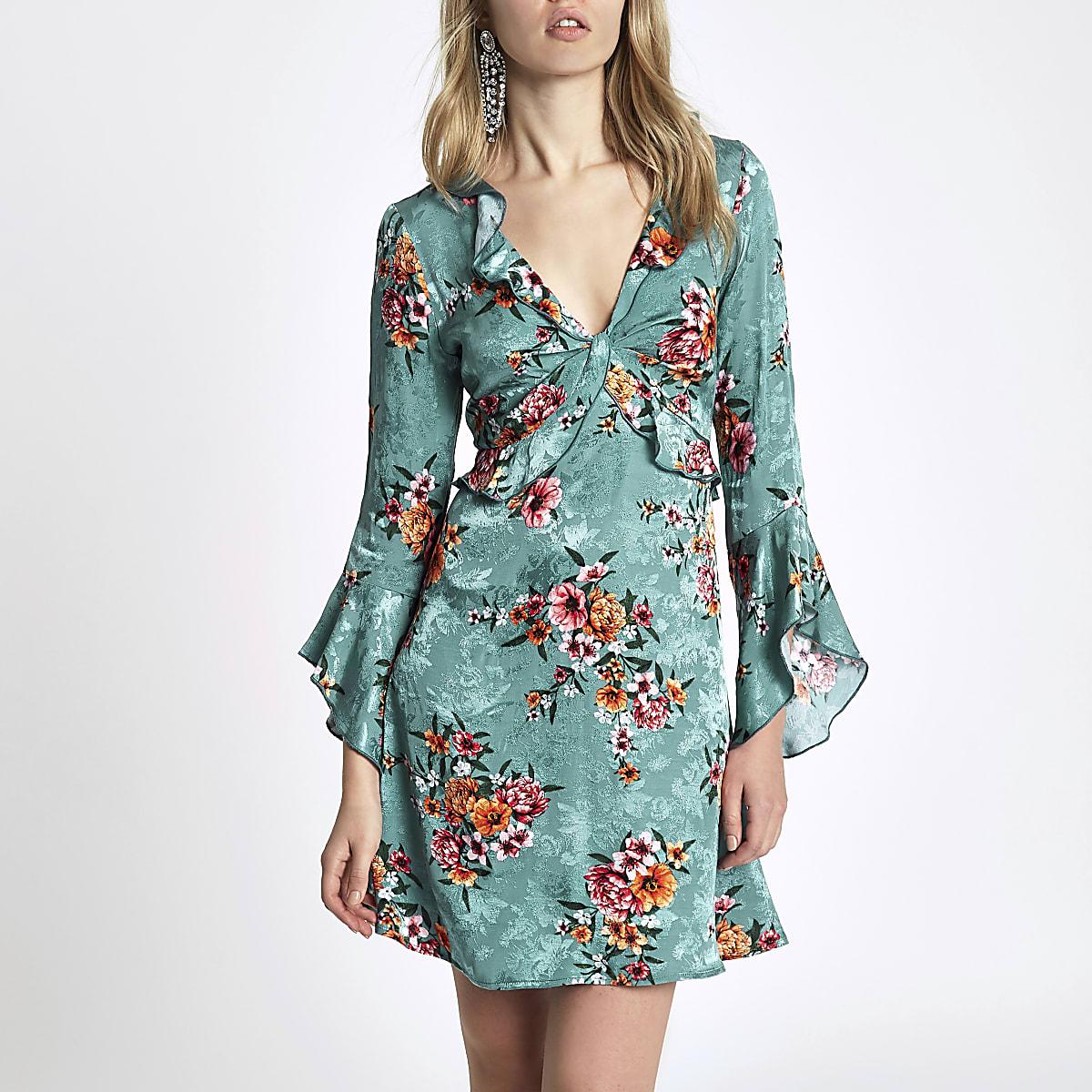 Blauwe jurk met bloemenprint, ruches voor en uitsnede op de rug
