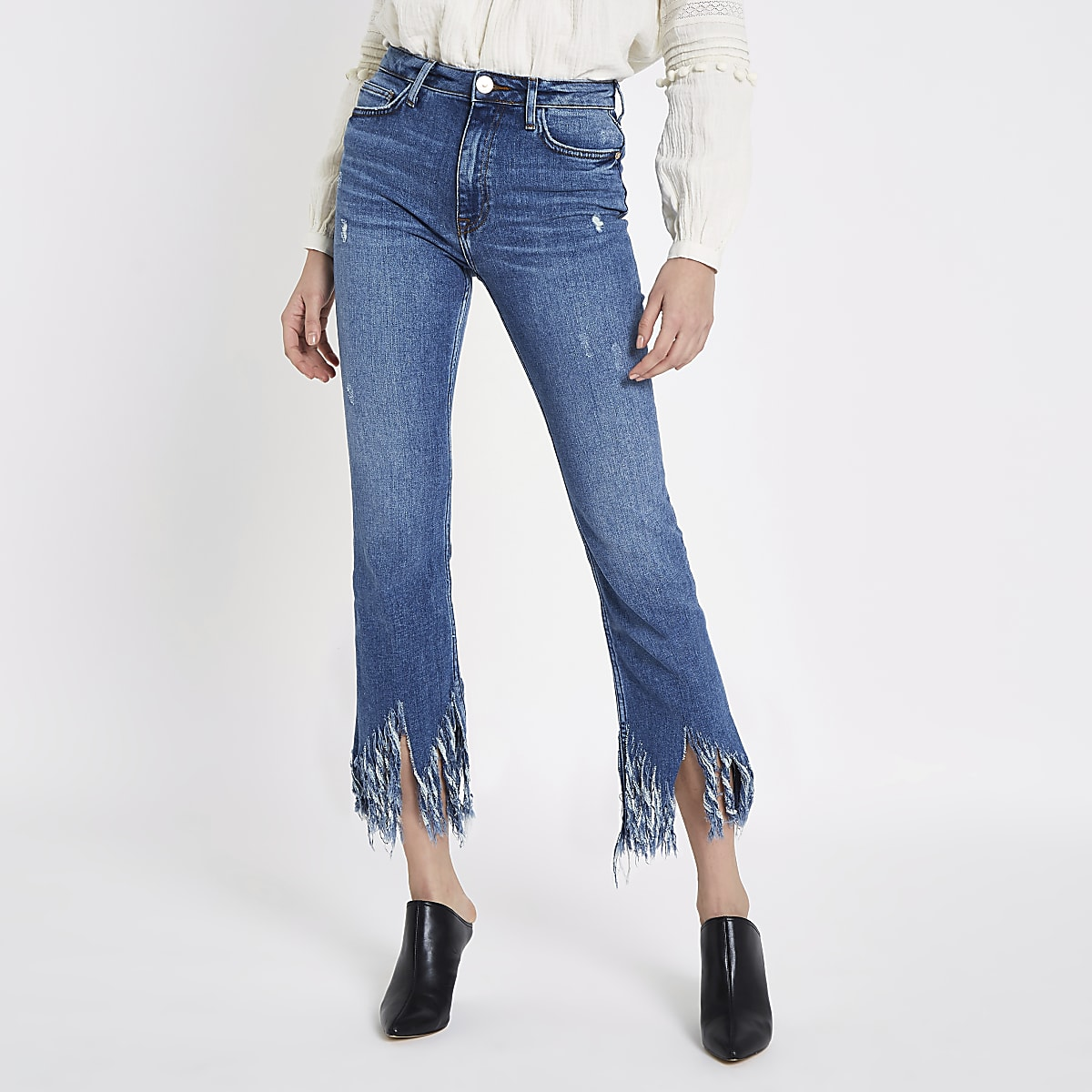 Mid blue fringed hem cropped flared jeans
