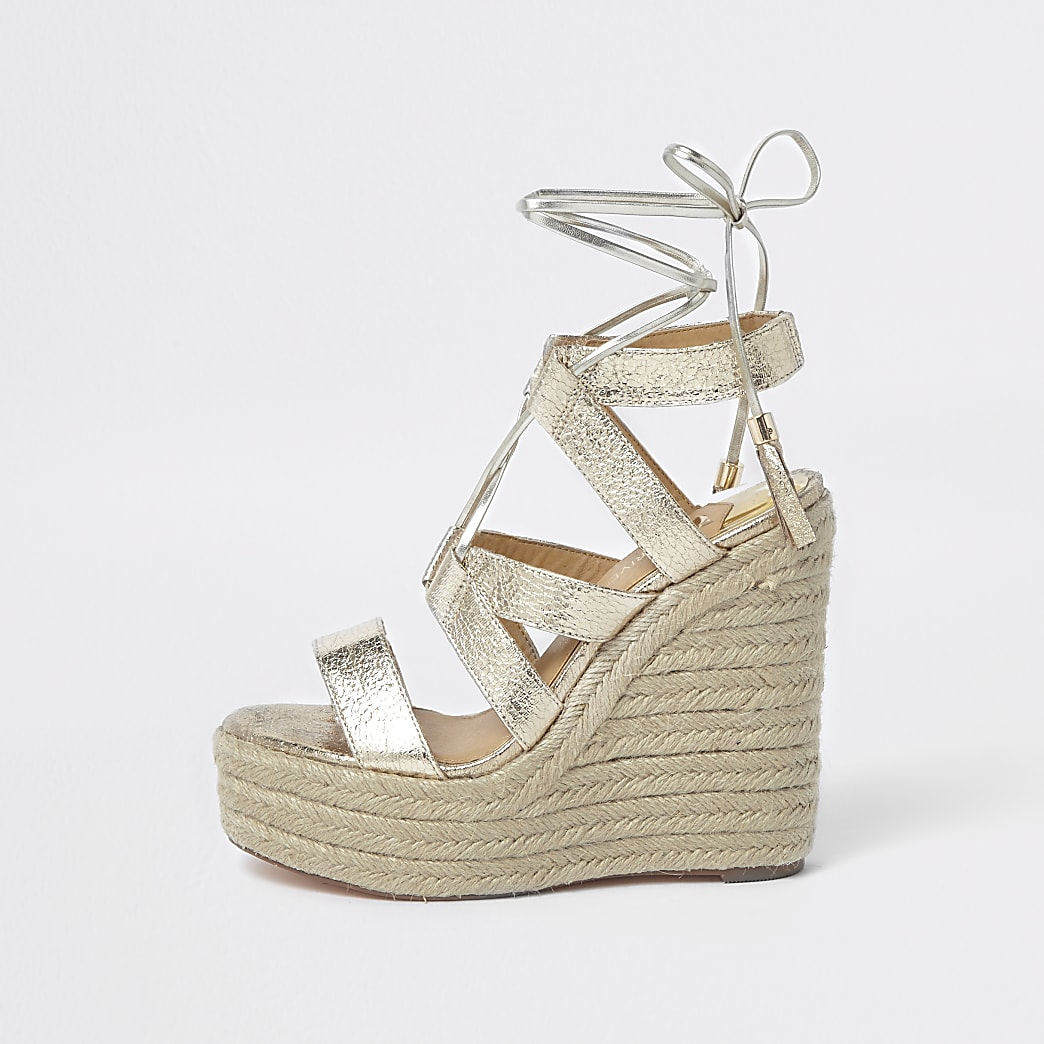 Gold metallic tie-up espadrille wedges
