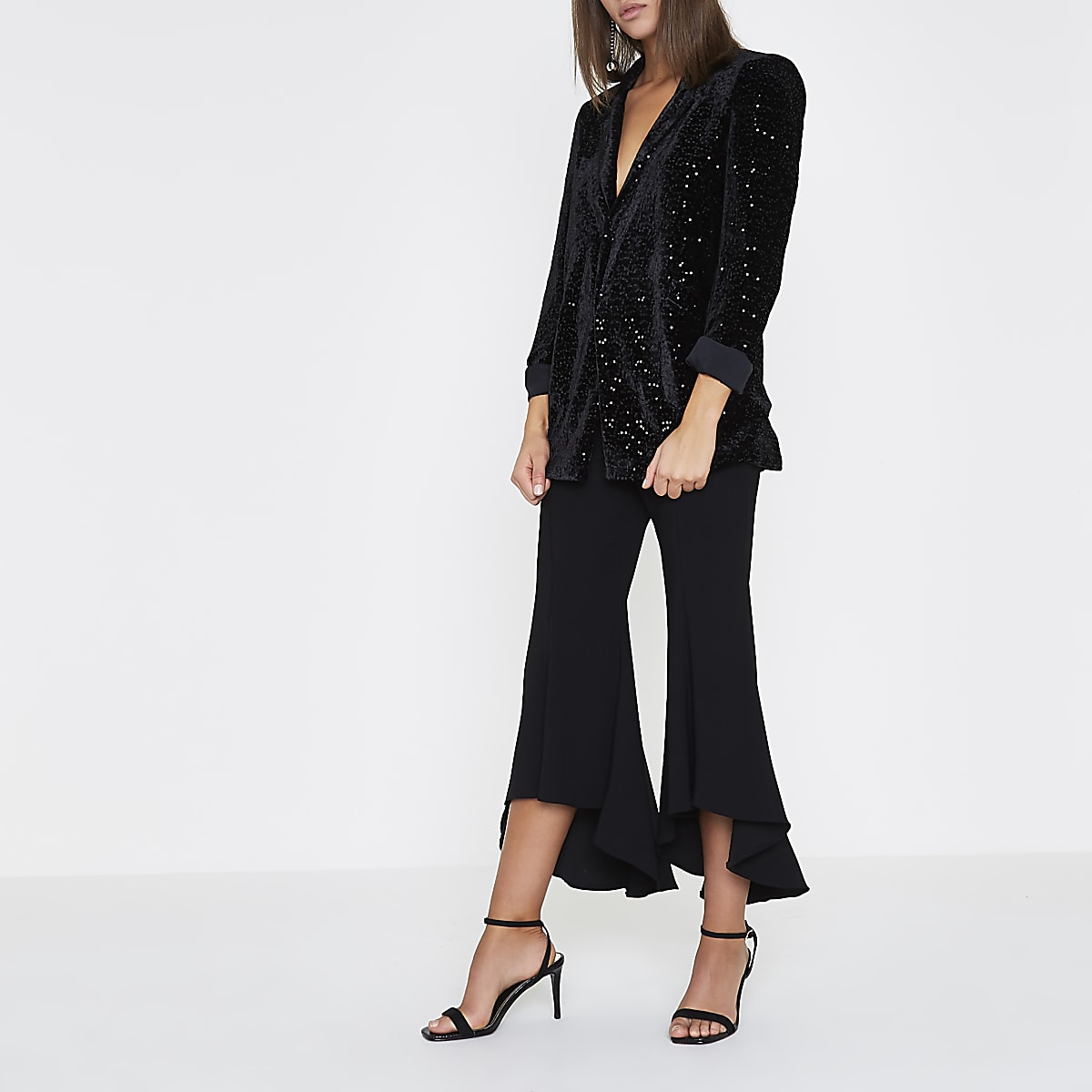 Black cropped flare trousers