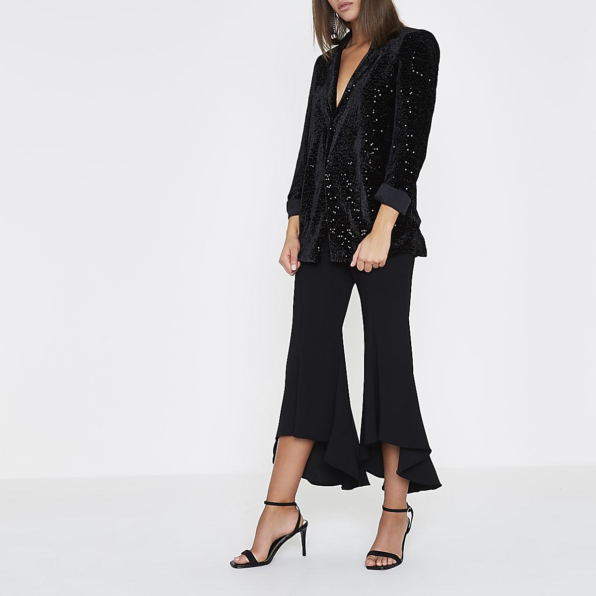 Zwarte bijgesneden wijduitlopende broek