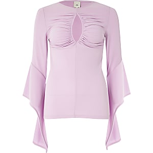 Pink ruched peekaboo bell sleeve top