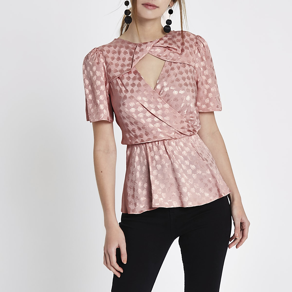 Light pink jacquard twist neck peplum top