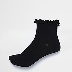 Chaussettes en maille torsadée noires à volants