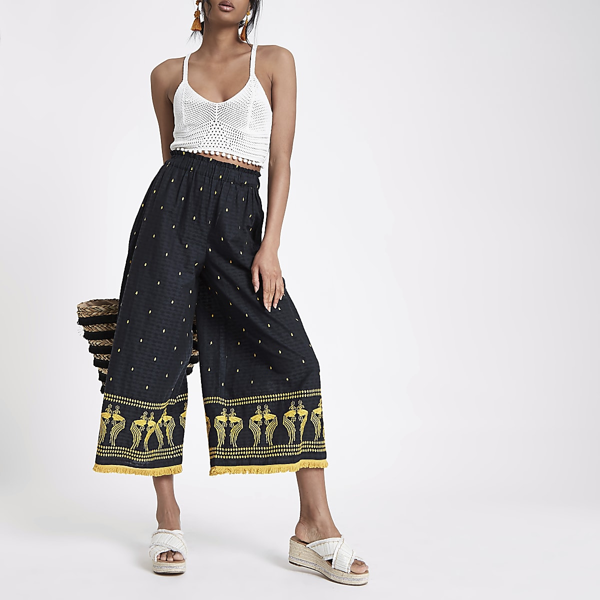 Navy embroidered fringe hem trousers