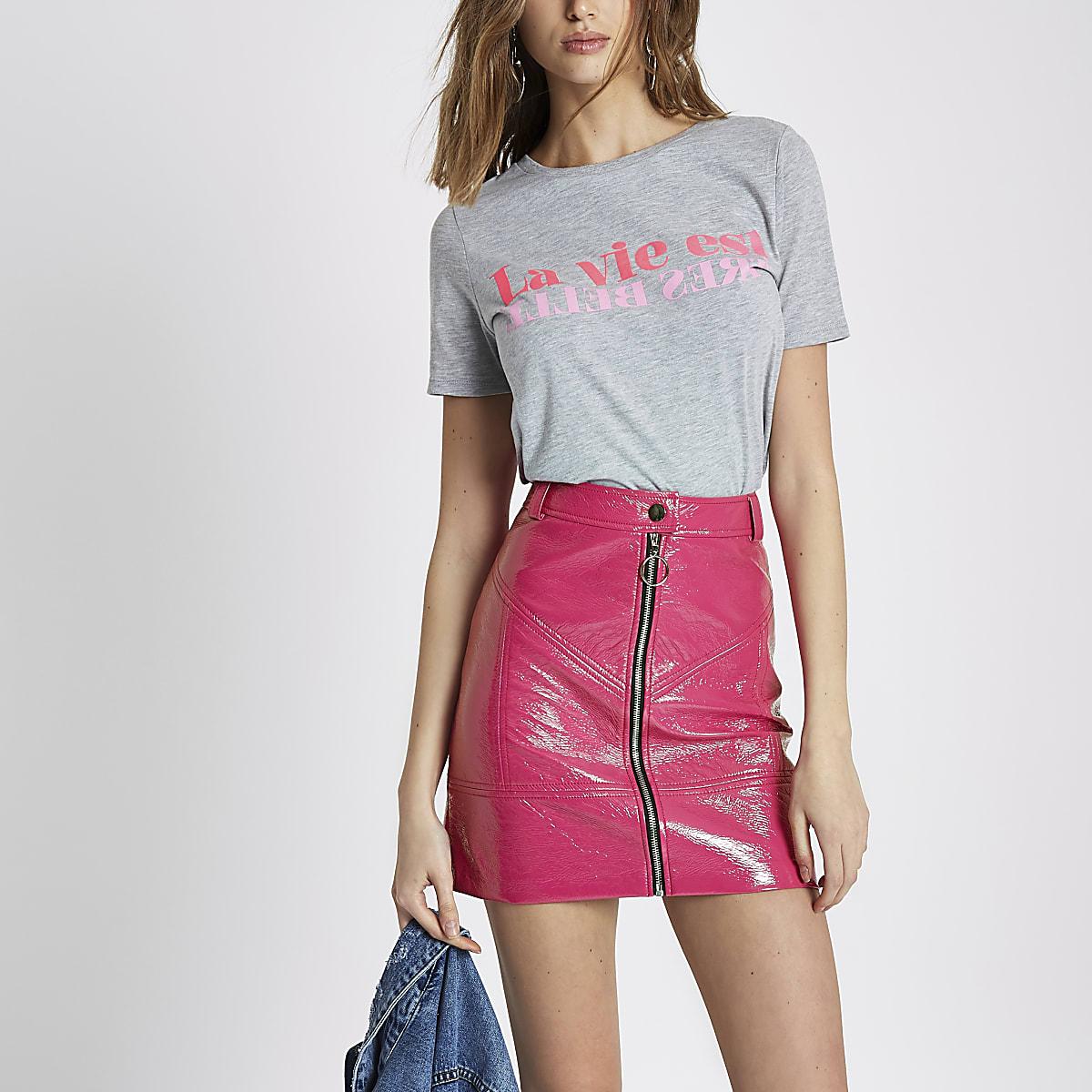 Bright pink vinyl zip front mini skirt