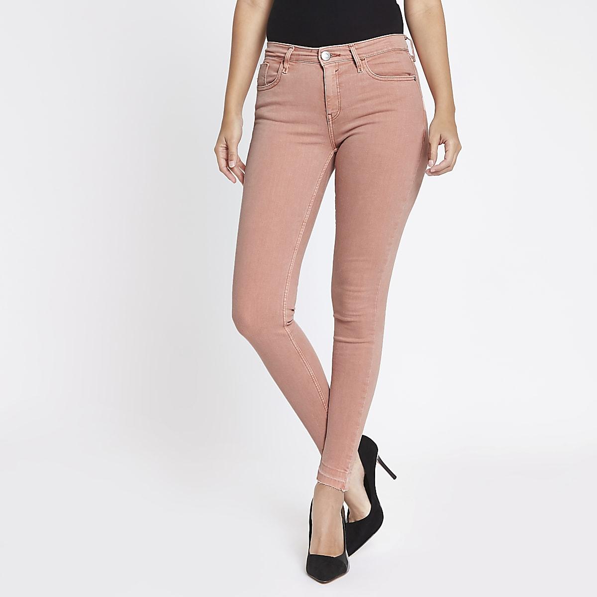 Pink Amelie released hem super skinny jeans