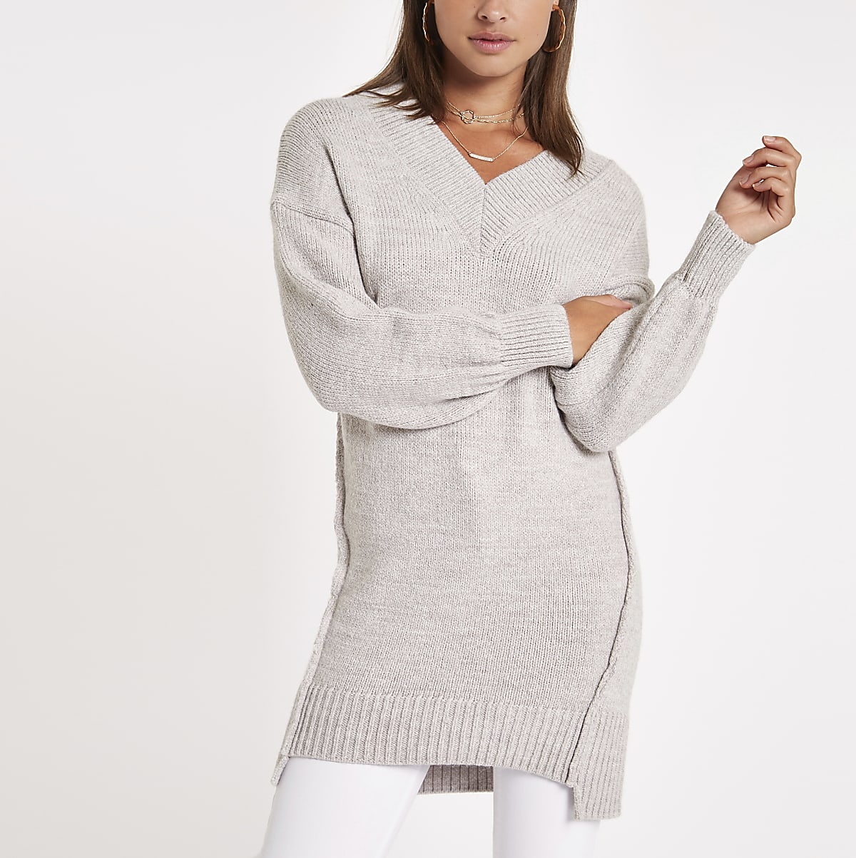Beige V neck stepped hem jumper