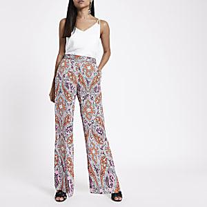 Petite orange paisley print wide leg trousers
