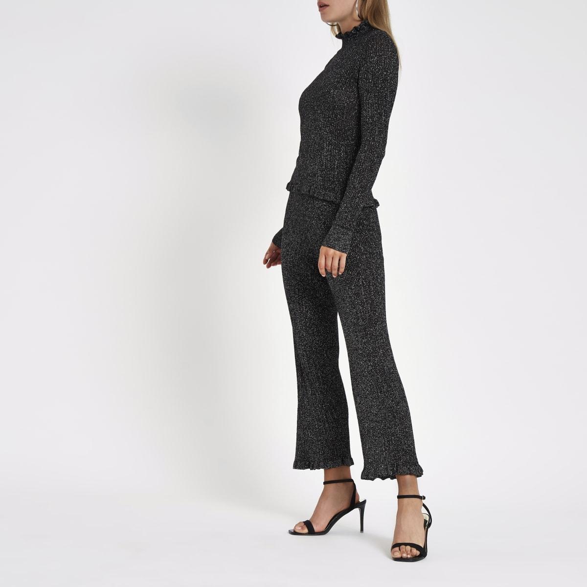 Black metallic knit frill hem pants