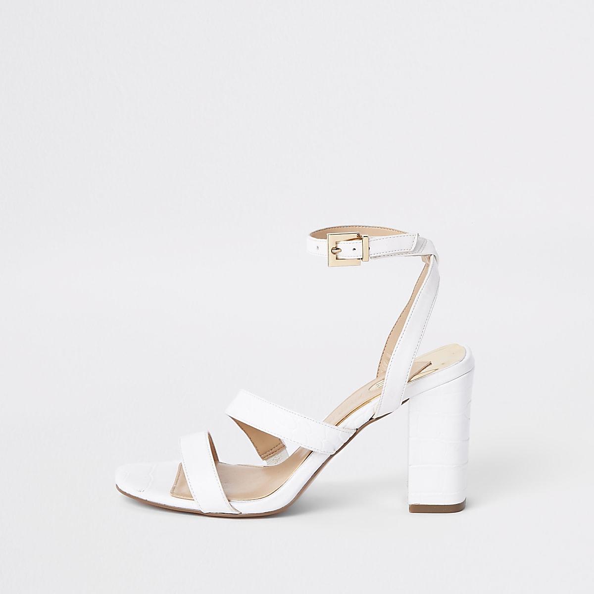 White asymmetric strappy block heel sandals
