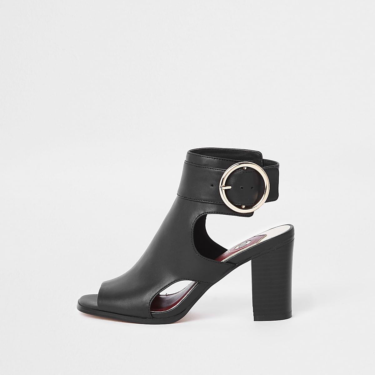 Black oversized buckle shoe boots