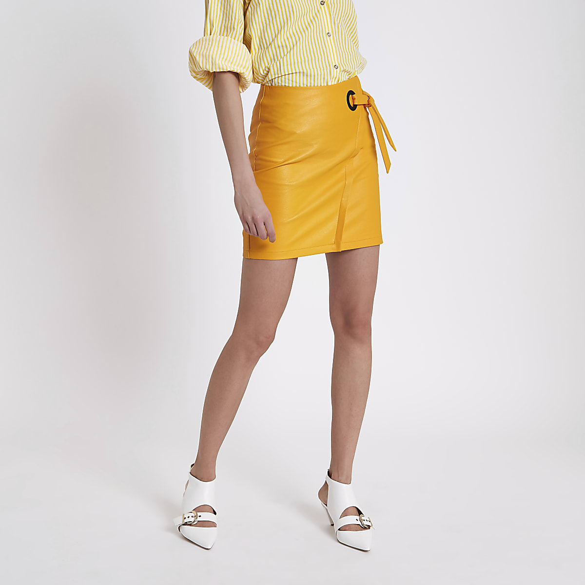 Orange wrap eyelet tie-up mini skirt