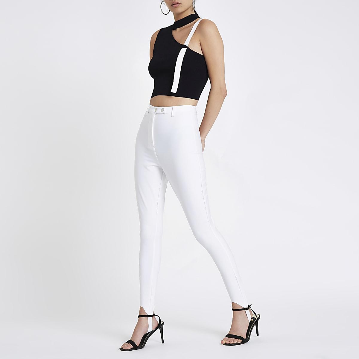 White high waisted stirrup leggings