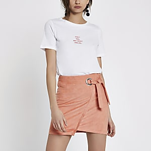 Pink wrap eyelet tie-up mini skirt