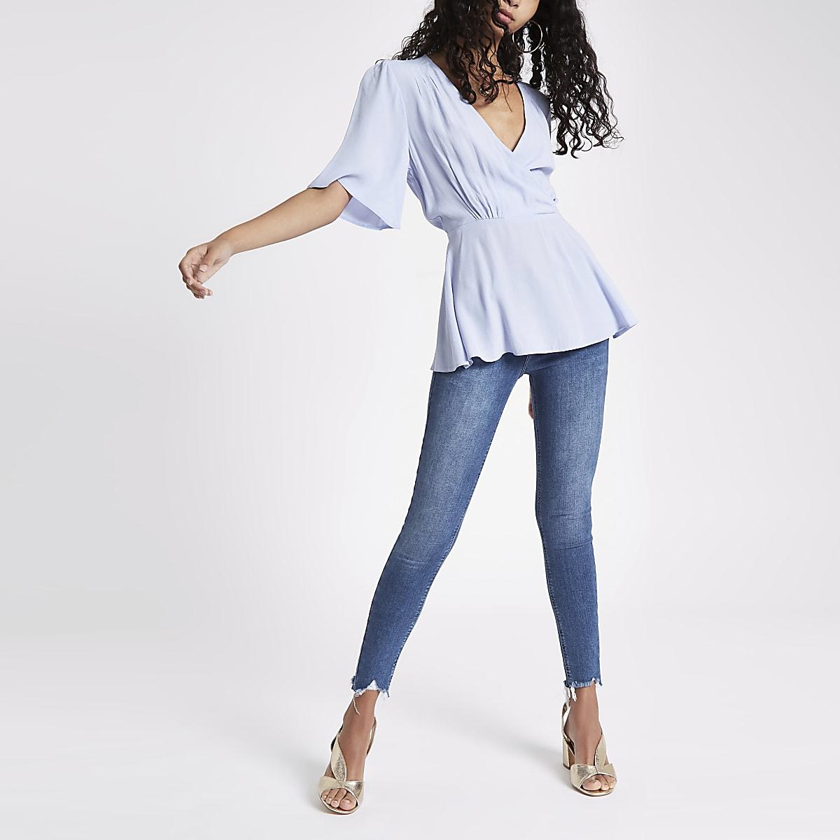 Blue short sleeve tie waist blouse