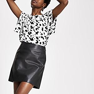 Mini jupe en cuir noir zippée