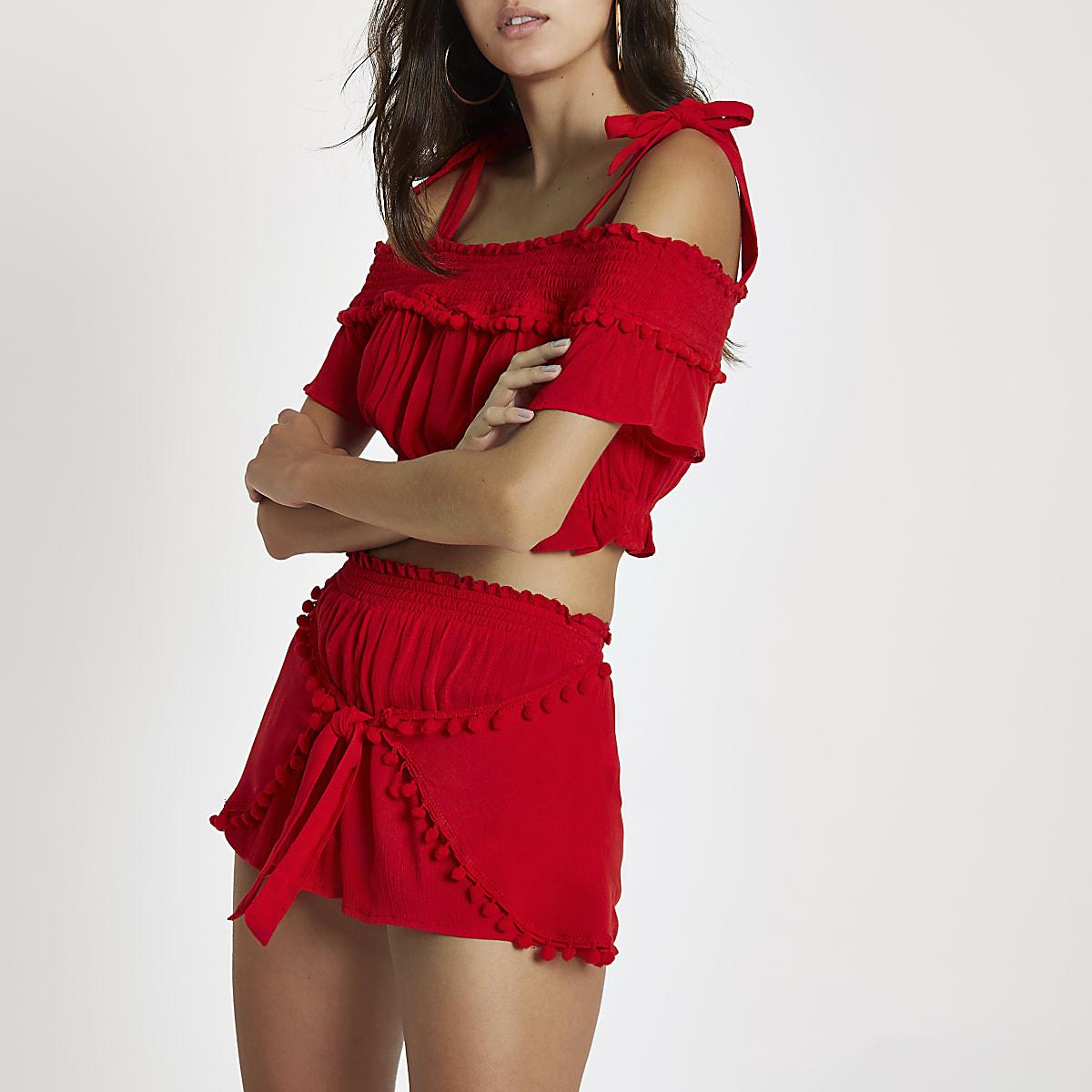Red pom pom tie front beach shorts