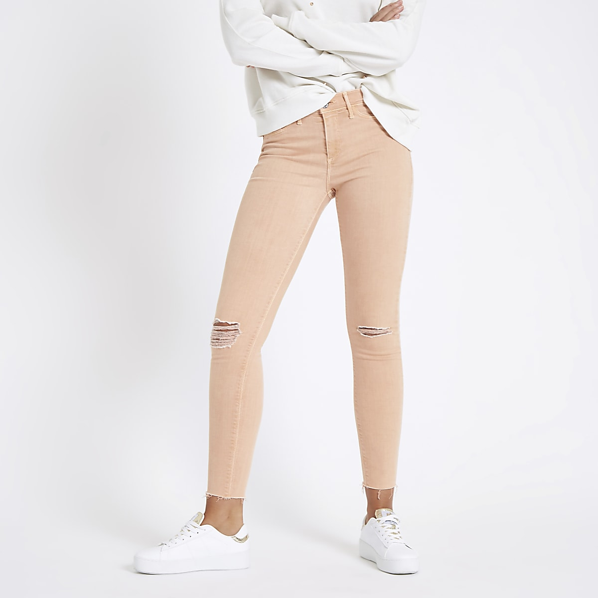 Orange Molly ripped mid rise jeggings