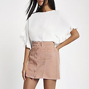 Pink corduroy button through mini skirt