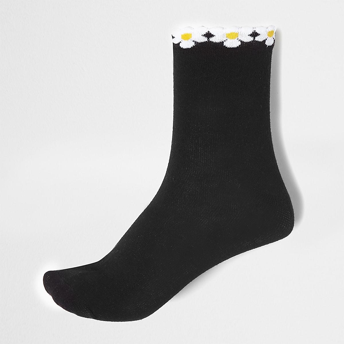 Socquettes noires motif pâquerettes à l'ourlet