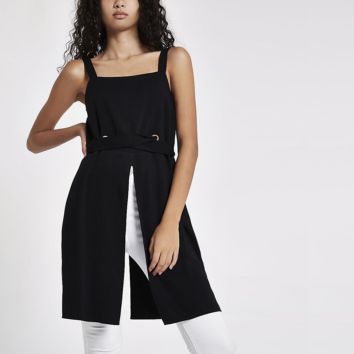 Zwarte lange cami top met oogjes en strik voor