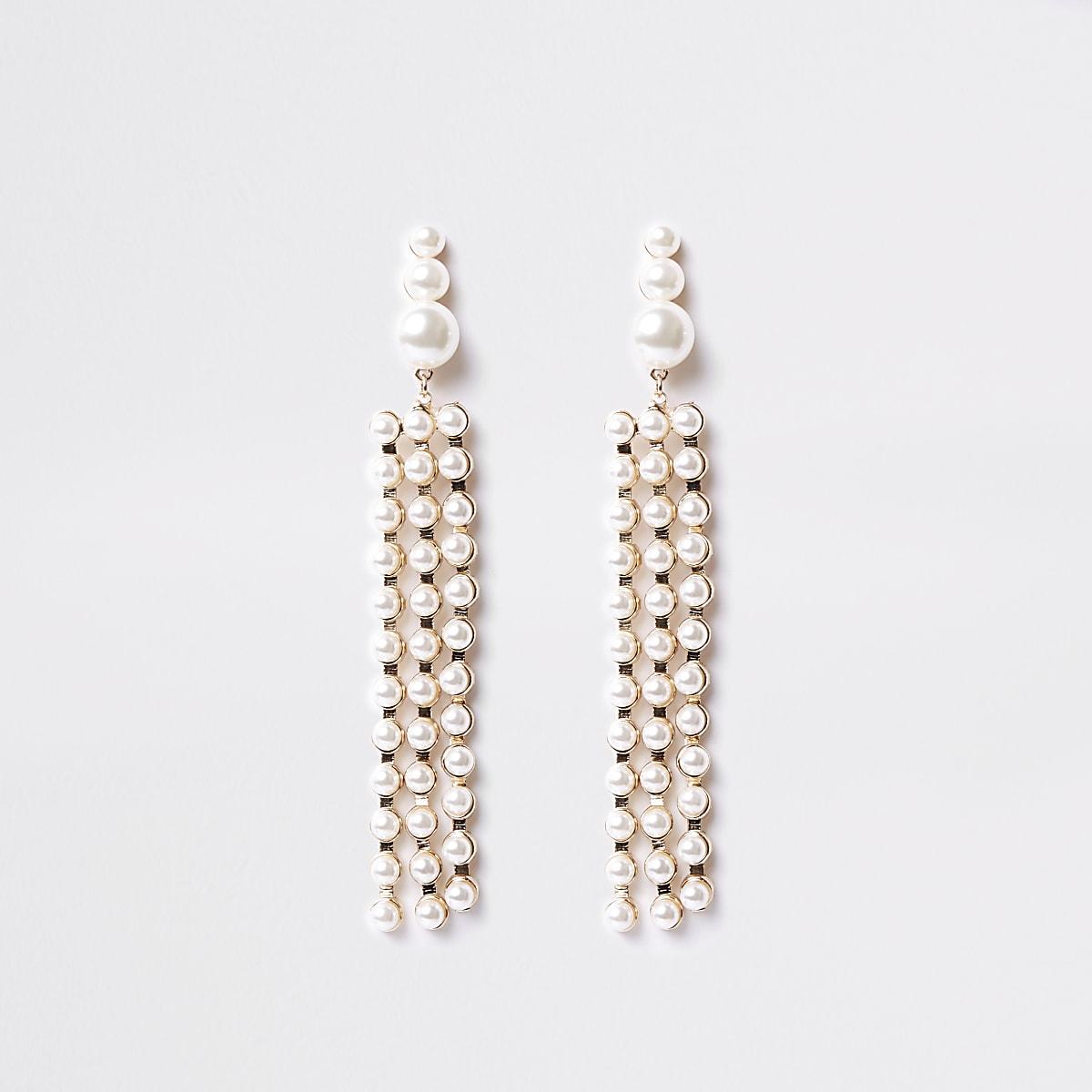 Pendants d'oreilles dorés avec perles